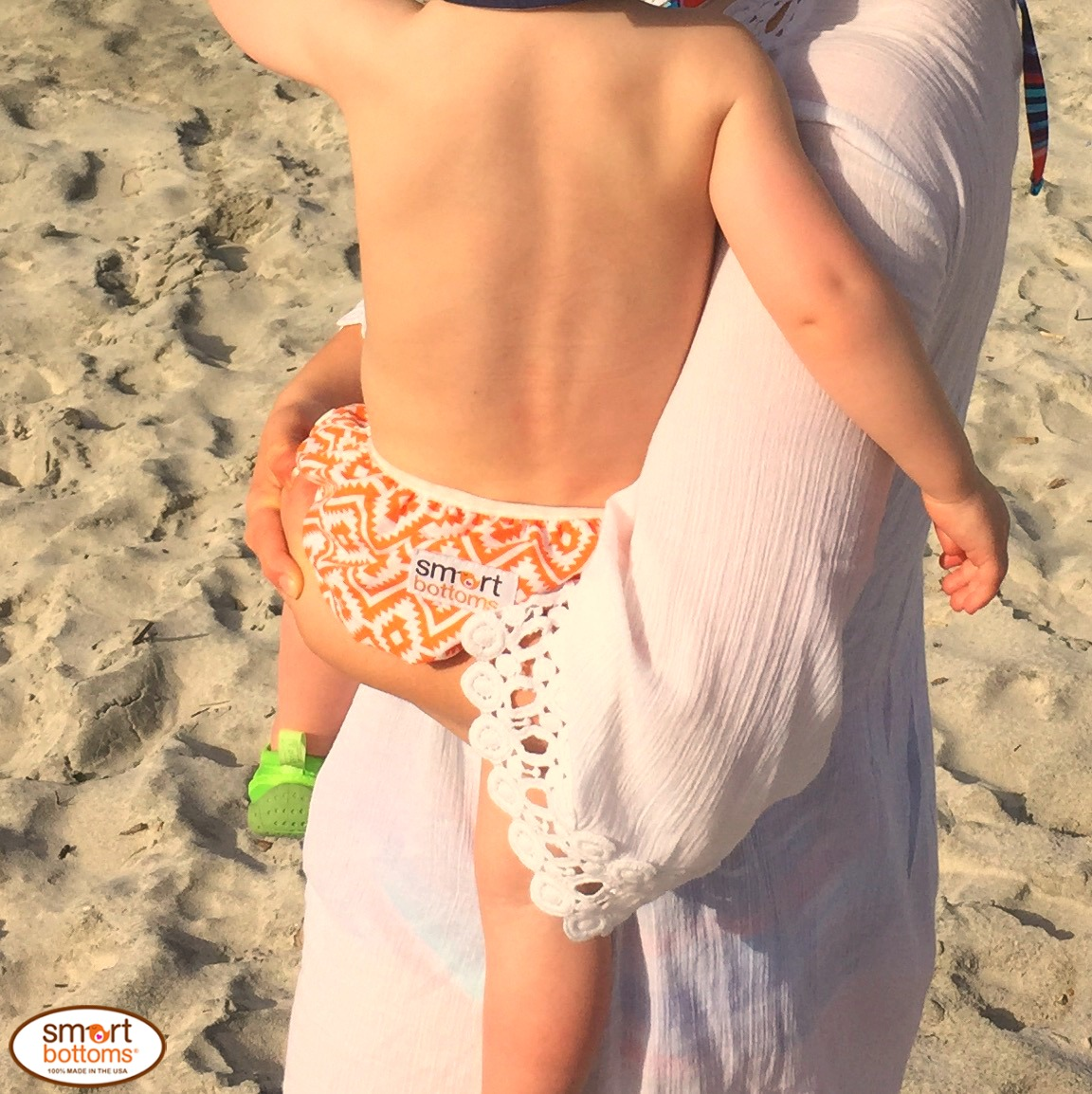 Smart Bottoms Swim Diaper orange and white aztec print Eduardo