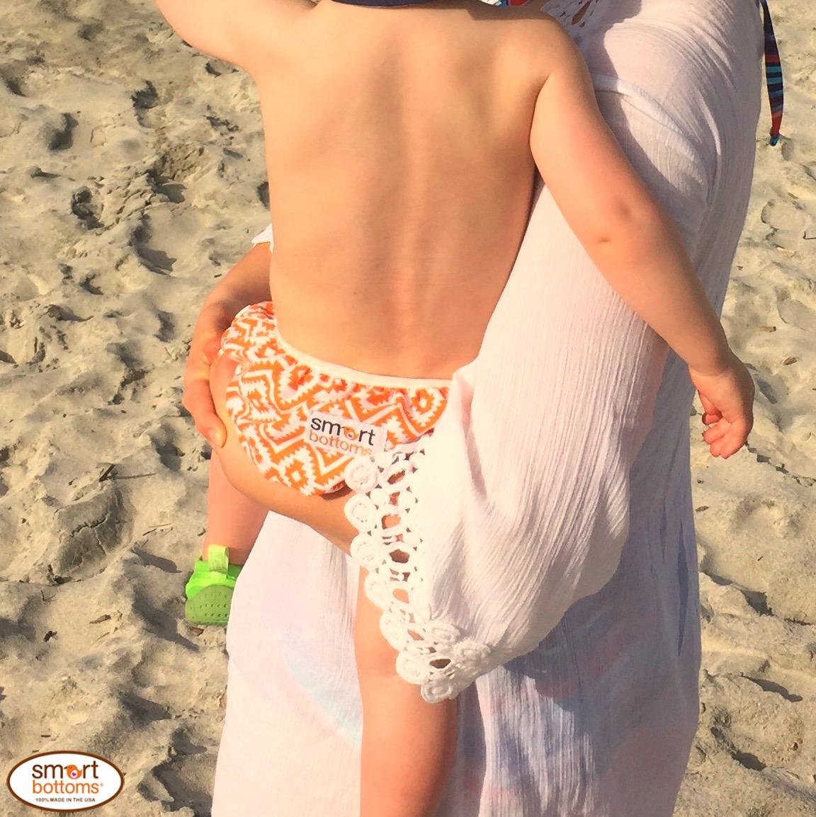 Smart Bottoms Swim Diaper orange and white aztec print Eduardo