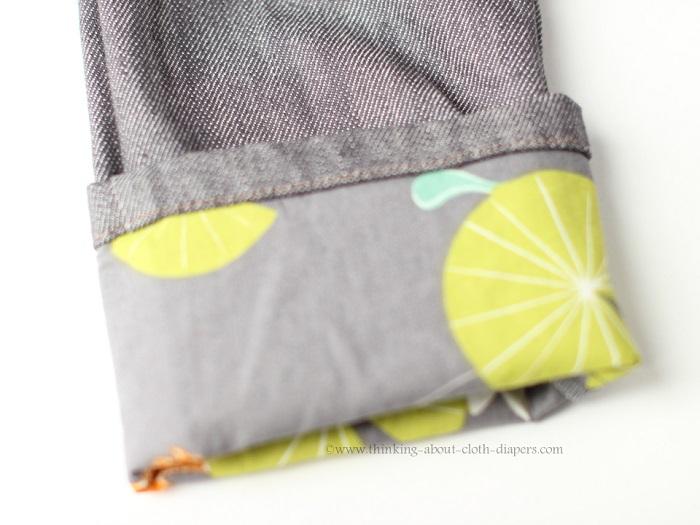 Roll-up cuffs on baby Project Pomona Jeans feature contrast fabric - grey Little Hipster with Koi fabric