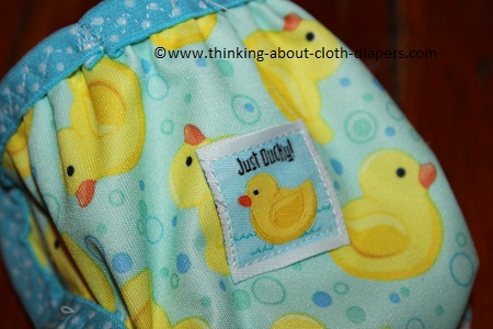 babyville boutique just ducky sewing tag on newborn diaper cover